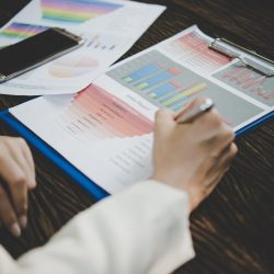 Business woman working with analysis marketing document .